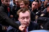 Em foto divulgada nas redes sociais, o ativista Nikolai Alekseev leva um soco durante o protesto (Reprodução/Nikolai Alekseev)
