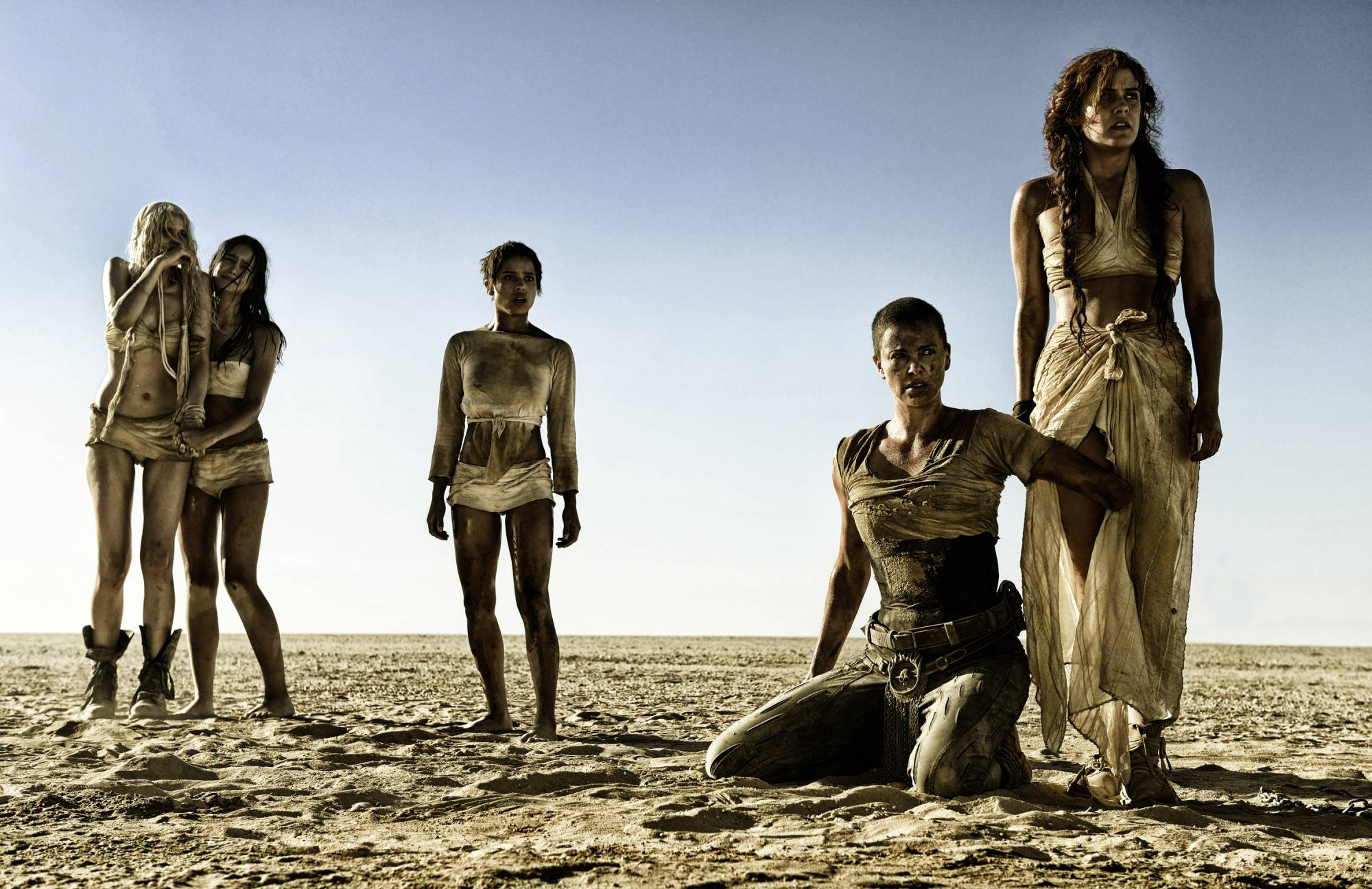 """This photo provided by Warner Bros. Pictures shows, from left, Abbey Lee as The Dag, Courtney Eaton as Cheedo the Fragile, Zoe Kravitz as Toast the Knowing, Charlize Theron as Imperator Furiosa and Riley Keough as Capable, in Warner Bros. Pictures' and Village Roadshow Pictures' action adventure film, """"Mad Max:Fury Road,"""" a Warner Bros. Pictures release. (Jasin Boland/Warner Bros. Pictures via AP)"""